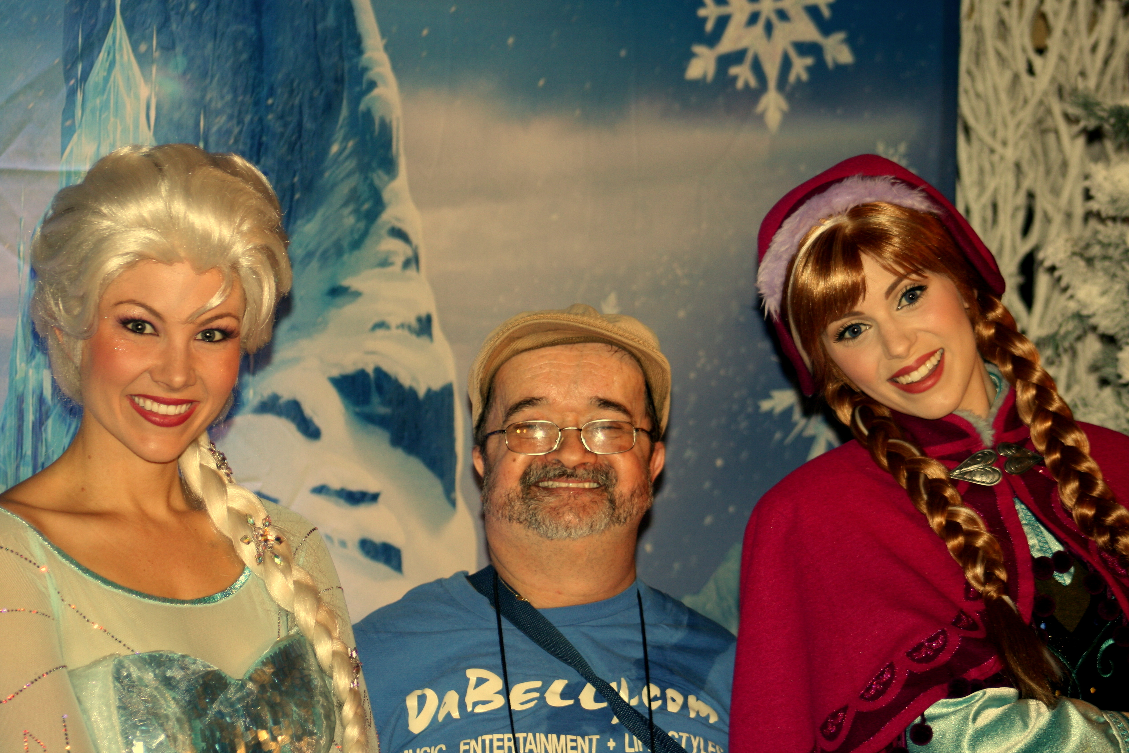 Uncle Rasputin warms up beauties from Frozen at Disneyland's 59th anniversary.